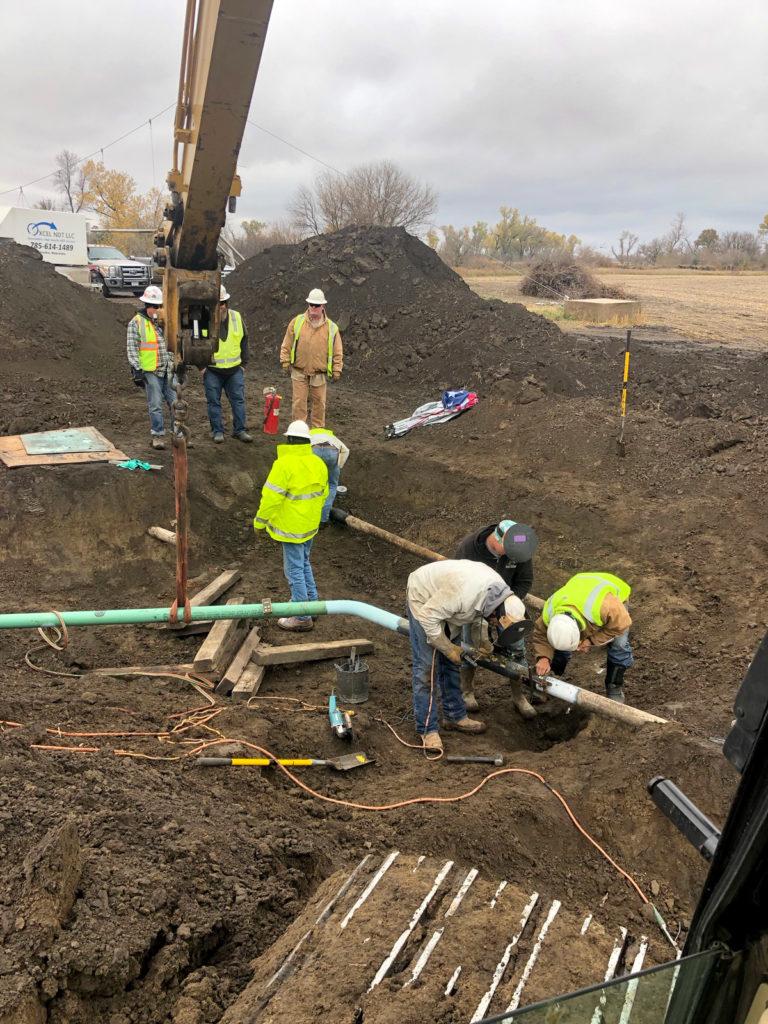 S.E.I. crew working on pipeline